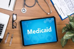 President Biden is trying to give Medicaid a much needed makeover, while bargaining with a bipartisan group of senators.